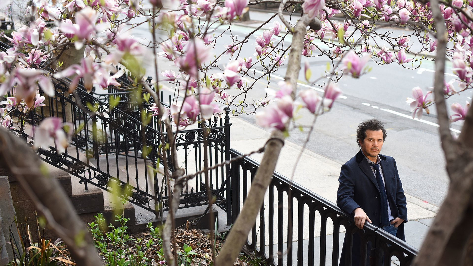 John Leguizamo under cherry blossoms
