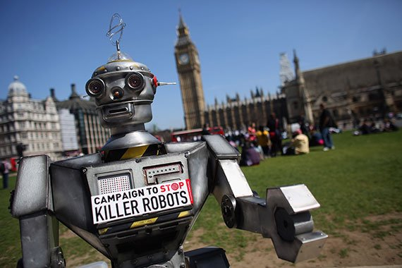 A robot distributes promotional literature in London's Parliament Square at the April 2013 launch of the Campaign to Stop Killer Robots, an international coalition working to preemptively ban fully autonomous weapons. (Photo: Oli Scarff/Getty Images)