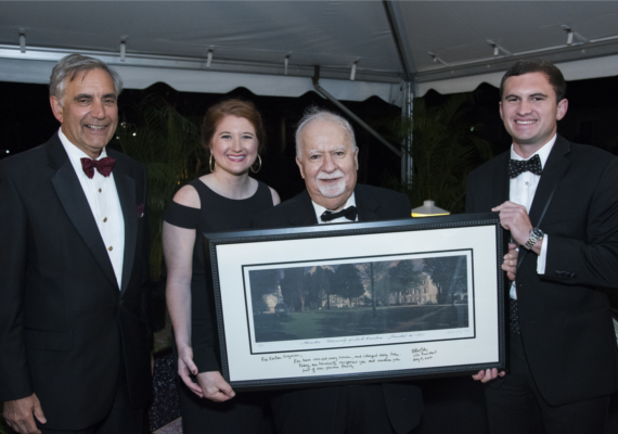 Vartan Gregorian with a signed print of the University of South Carolina's historic Horseshoe green