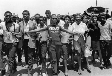 Students marching to a funeral, 1981. Photo by Omar Badsha