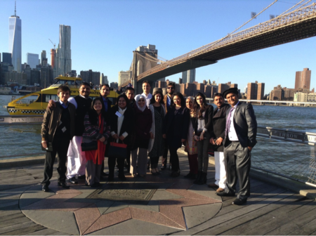 Young Pakistani visitors pose in front of a New York City icon: the Brooklyn Bridge.