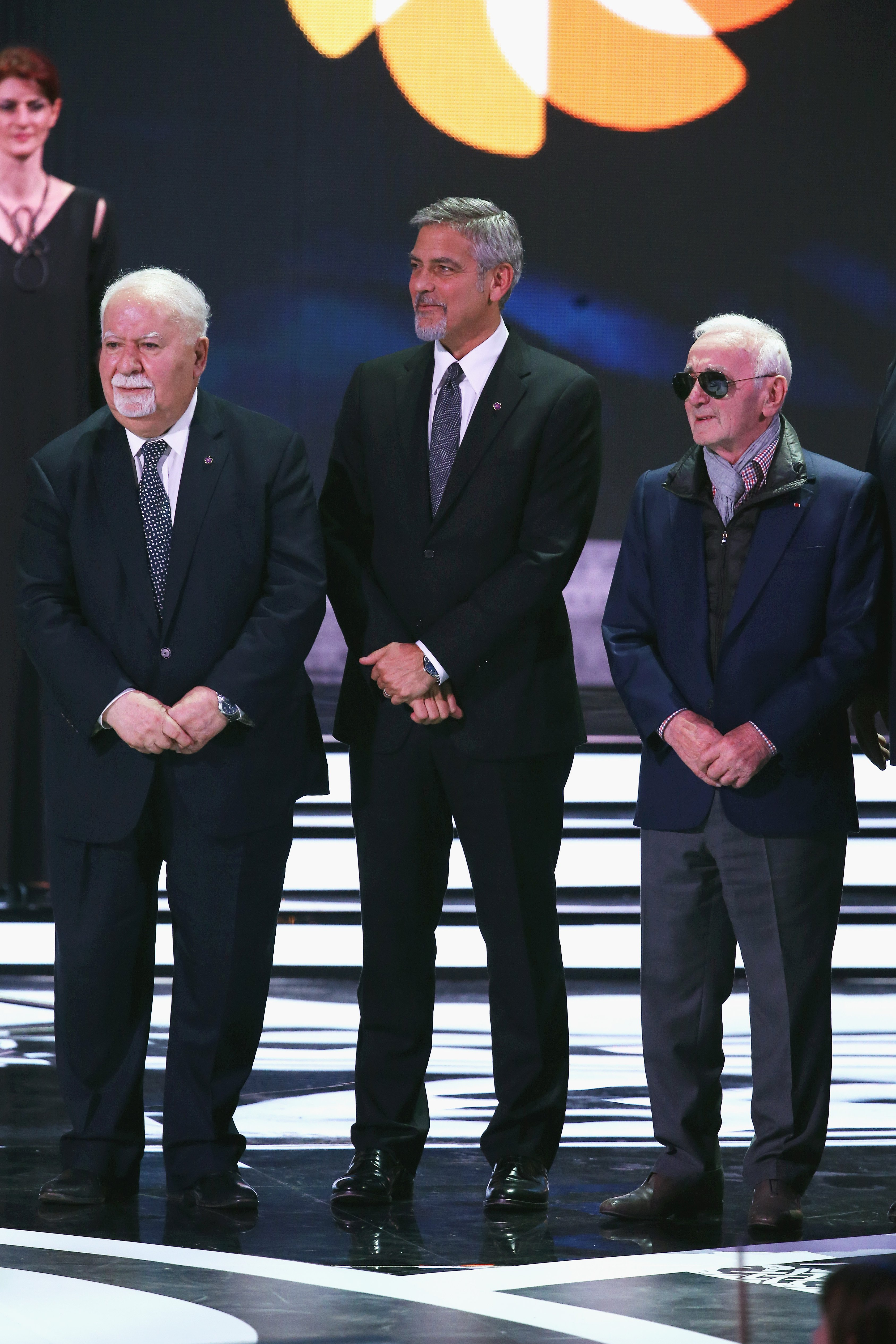 Aurora_Prize_co-founder_Vartan_Gregorian_Selection_Comittee_Co-Chair_George_Clooney_and_musician_Charles_Aznavour_on_stage_at_the_Aurora_Prize_Ceremony.JPG
