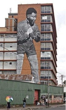 Commissioned by the Maboneng precinct in Johannesburg, South Africa, as a gift to the city in the memory of Nelson Mandela, South African artist Freddy Sam, painted this 10-story mural.
