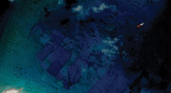 "From the Asia Maritime Transparency Initiative's ""Island Tracker,"" satellite imagery of land reclamation on Fiery Cross Reef, part of China's largescale island-building in the South China Sea. (Photo: CSIS/AMTI DigitalGlobe)"