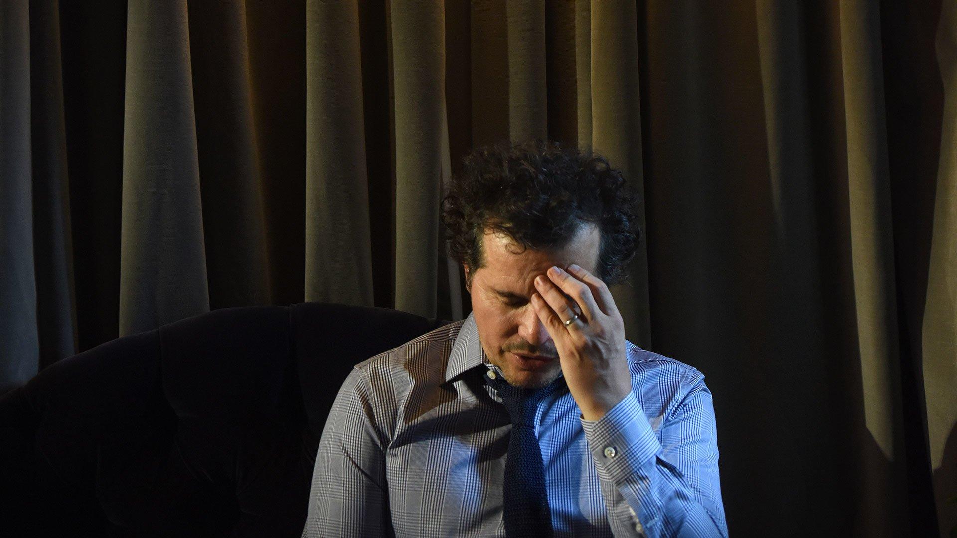 John Leguizamo  contemplating
