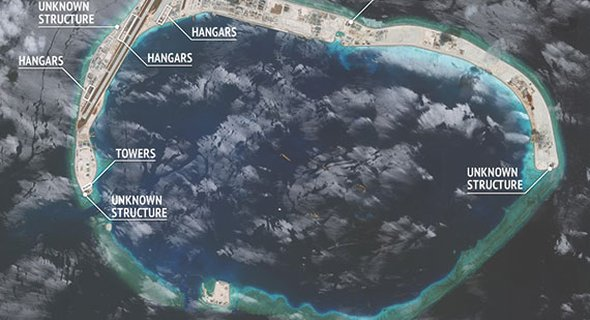 "According to AMTI's website: ""Each of the three islets [Fiery Cross, Subi, and Mischief reefs] will soon have hangar space for 24 fighter-jets plus 3–4 larger planes."" (Photo: CSIS/AMTI DigitalGlobe)"